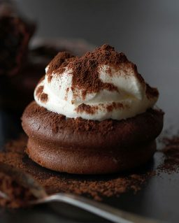 a chocolate cake with whipped cream topping