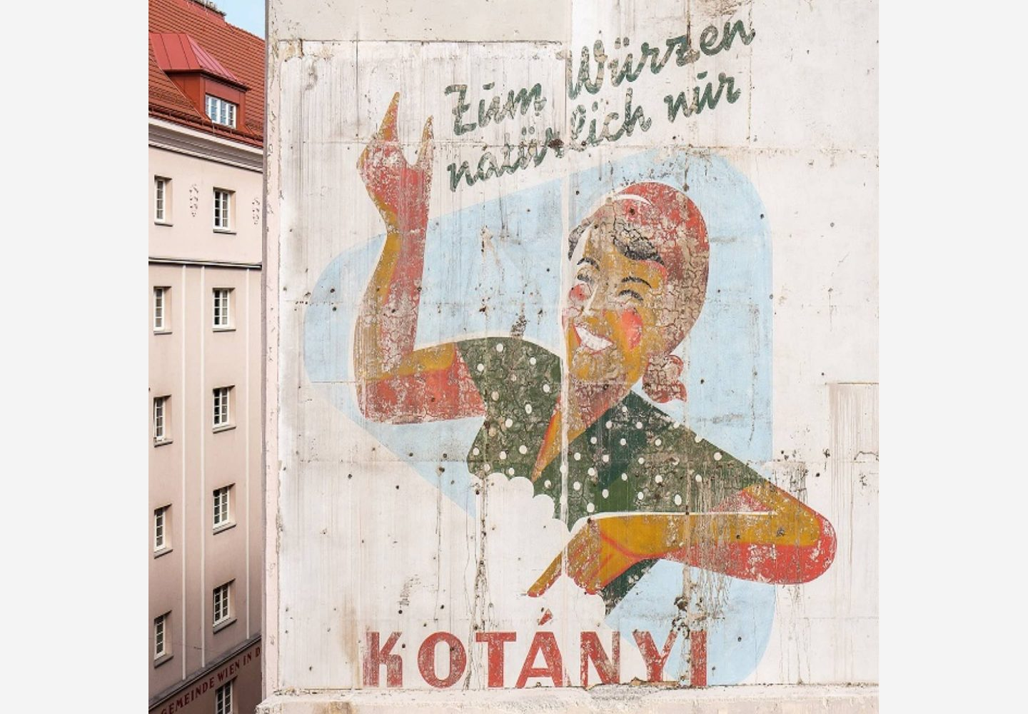 The outside of a Viennese building featuring Kotányi advertising.
